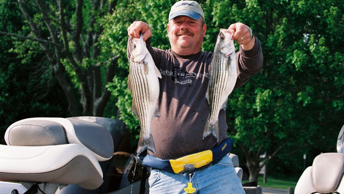 Fisherman with 2 Rockfish.jpg